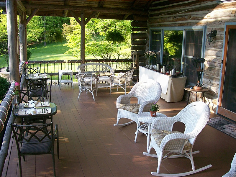 whicker rockers and black patio tables on porch