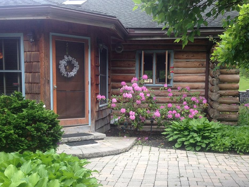 Front door of chalet of canandaigua log cabin