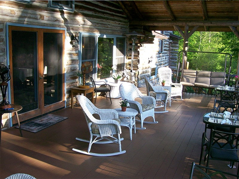 whicker rocking chairs on log cabin porch