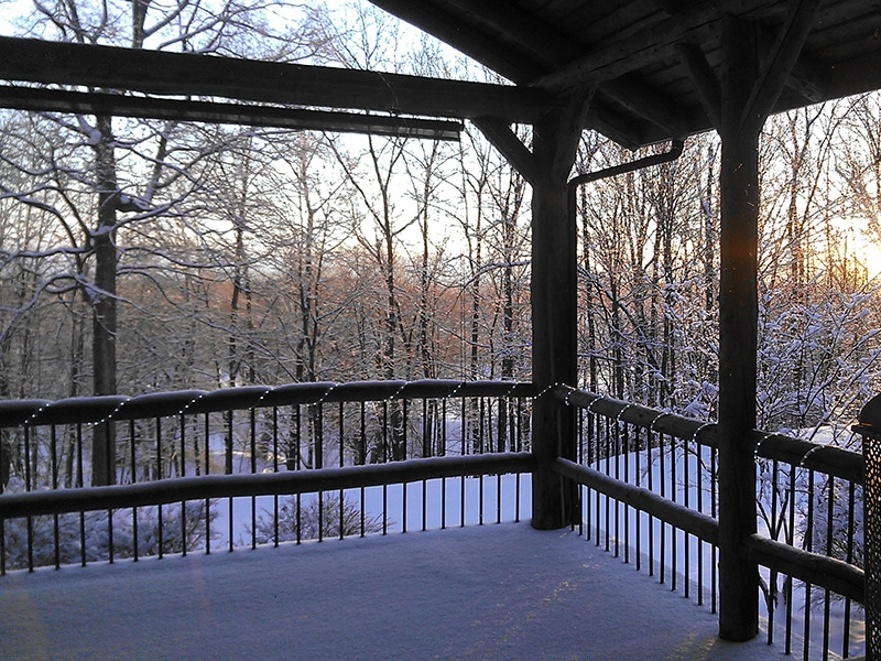 winter view from log cabin deck