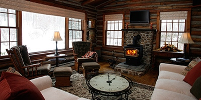 log cabin living room with wood burning stove