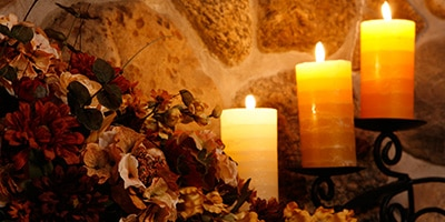 candles on harth with fall decorations