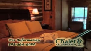 chalet of canandaigua logo overlaying bedroom